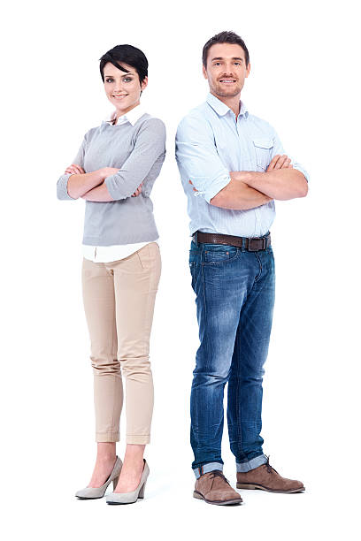 Positive attitudes are the foundation to their success Two experienced and confident businesspeople crossing their arms while isolated on white smart casual stock pictures, royalty-free photos & images