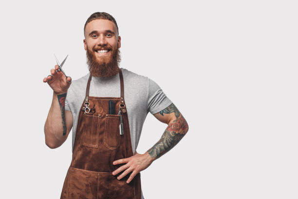 Positive barber with sharp scissors stock photo
