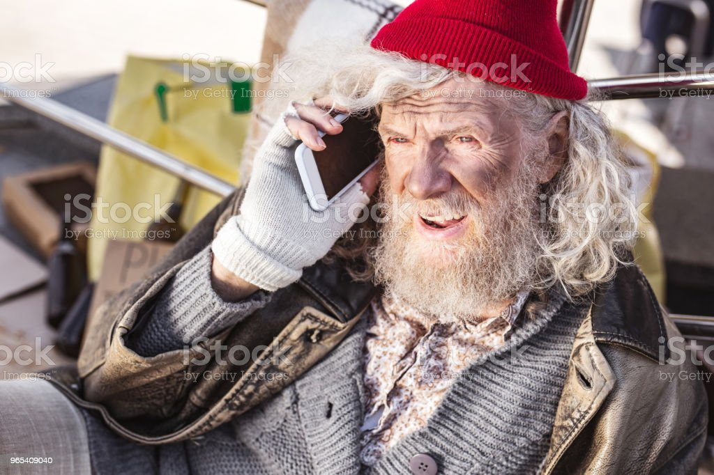 Positive bearded man having a phone conversation zbiór zdjęć royalty-free