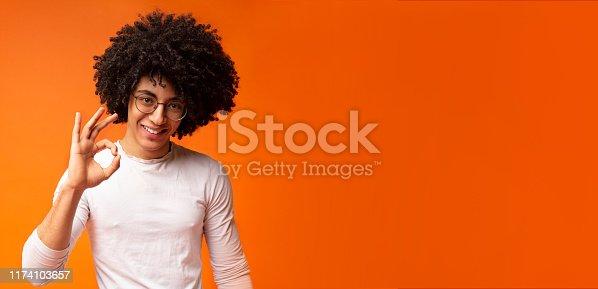istock Positive black millennial man gesturing ok sign 1174103657