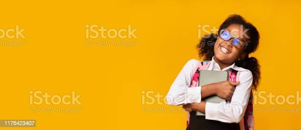 Positive black schoolgirl embracing book studio shot panorama picture id1175423407?b=1&k=6&m=1175423407&s=612x612&h=igzhq9usis4ybdntuq pf nho cghqravmetqvkcway=
