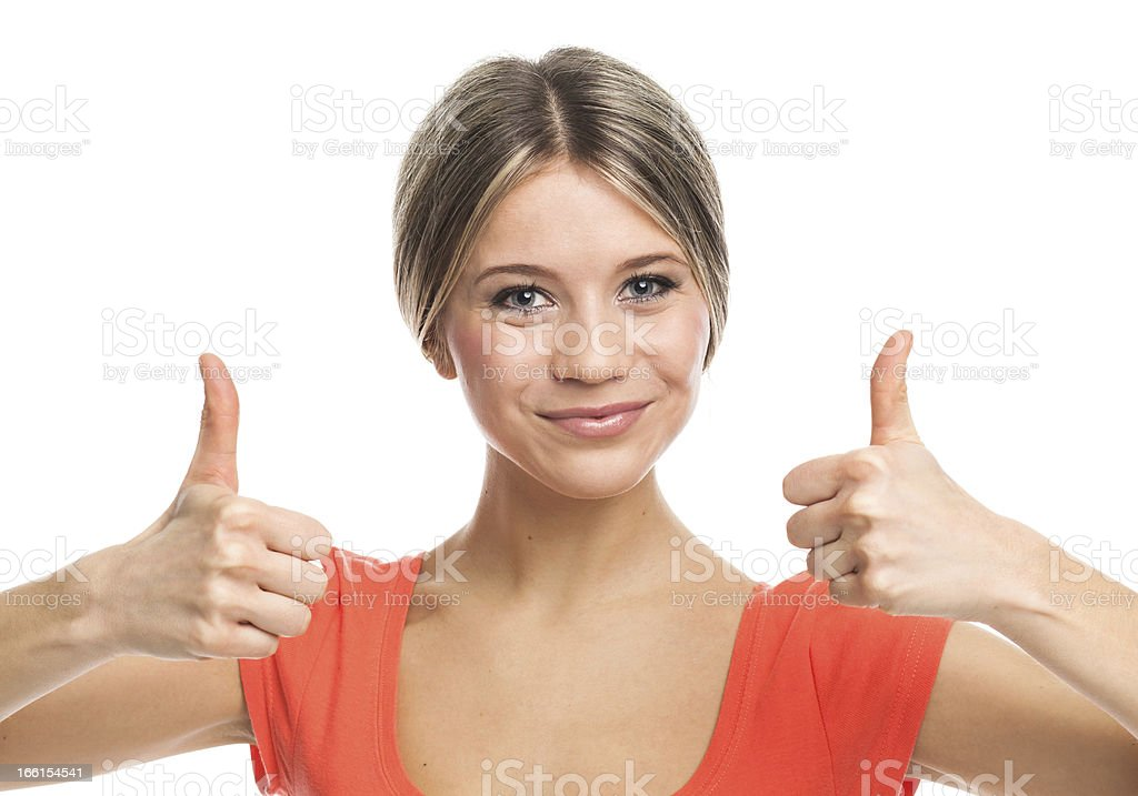 Positive blond girl with thumbs up royalty-free stock photo