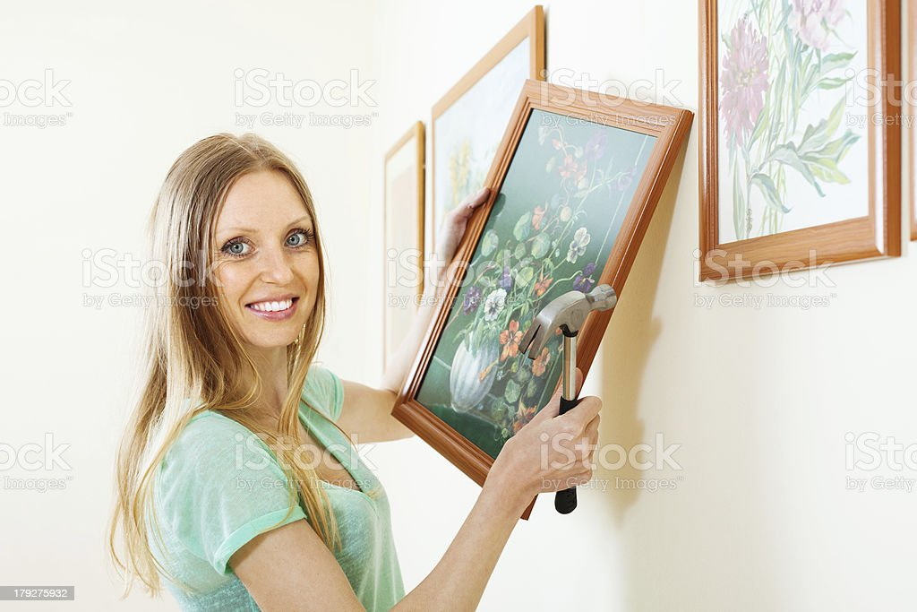 Positive blonde woman with picture royalty-free stock photo