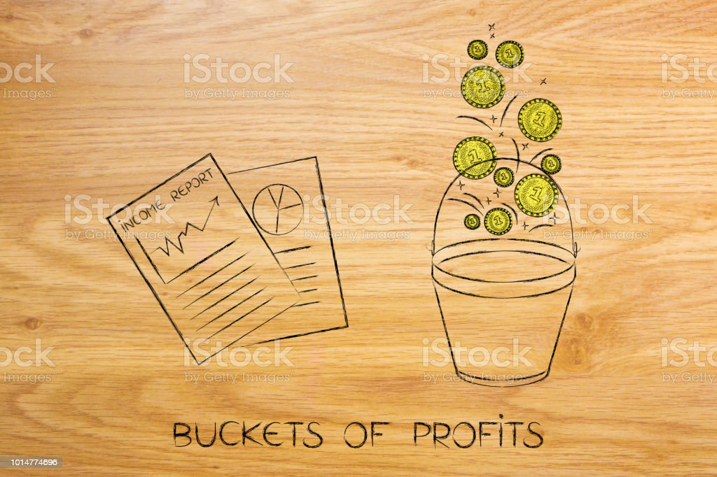 positive business income report next to bucket with coins dropping in stock photo
