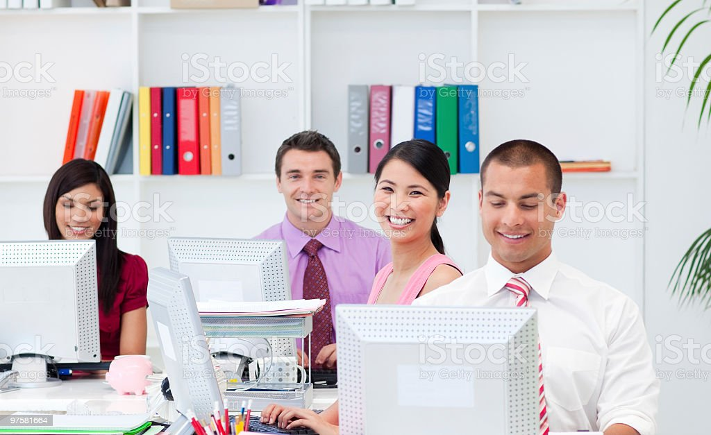 Positive business people working at computers royalty-free stock photo