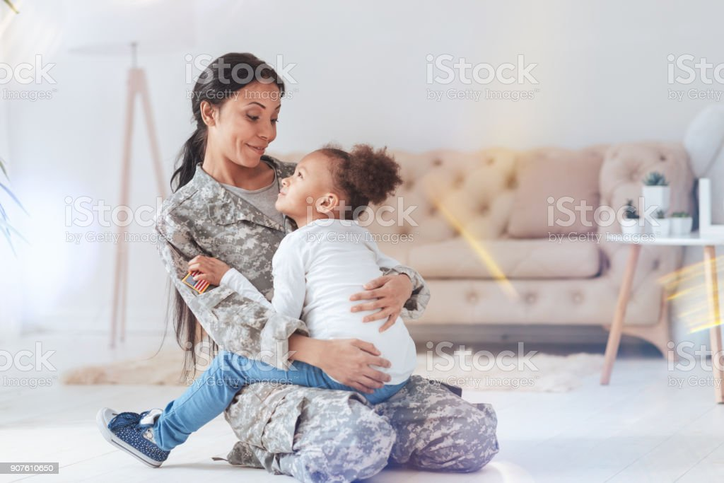 Positive cheerful woman spending time with her daughter stock photo