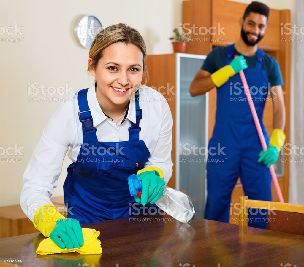 Positive cleaners cleaning and dusting stock photo