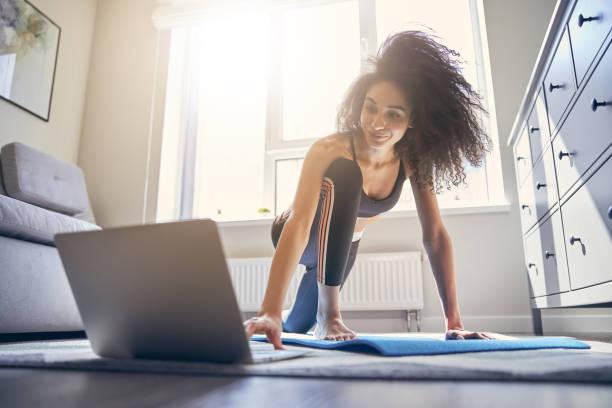 Positive delighted brunette female person training online stock photo