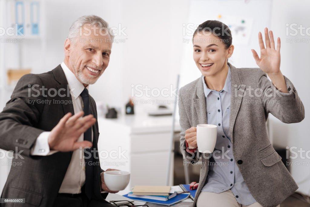Positiv erfreut Kollegen schwenkten ihre Hände Lizenzfreies stock-foto