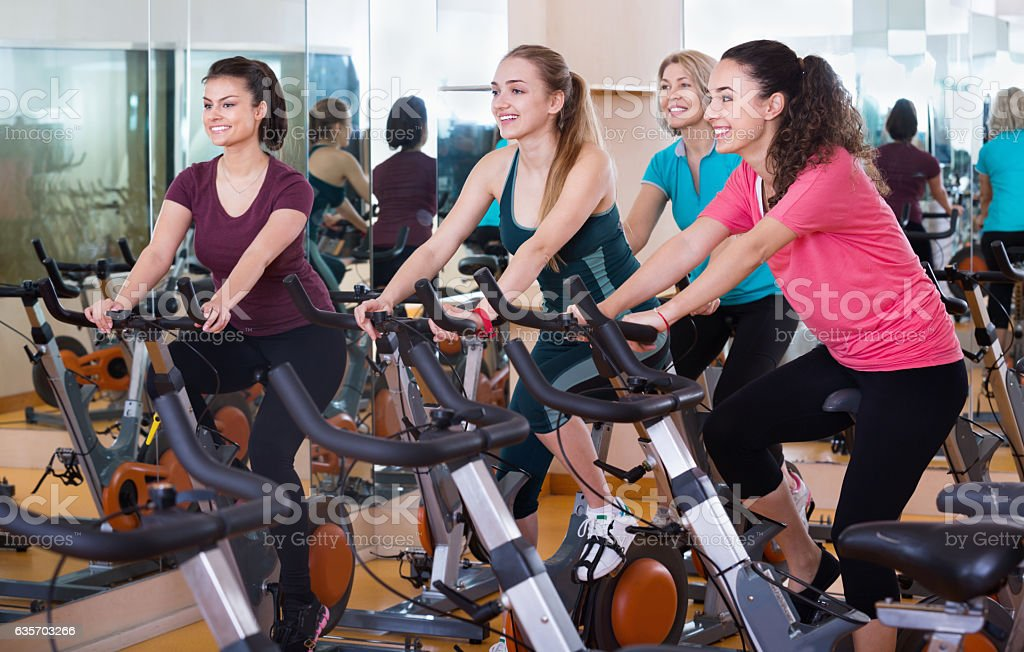 Positive  elderly and young women working out hard royalty-free stock photo