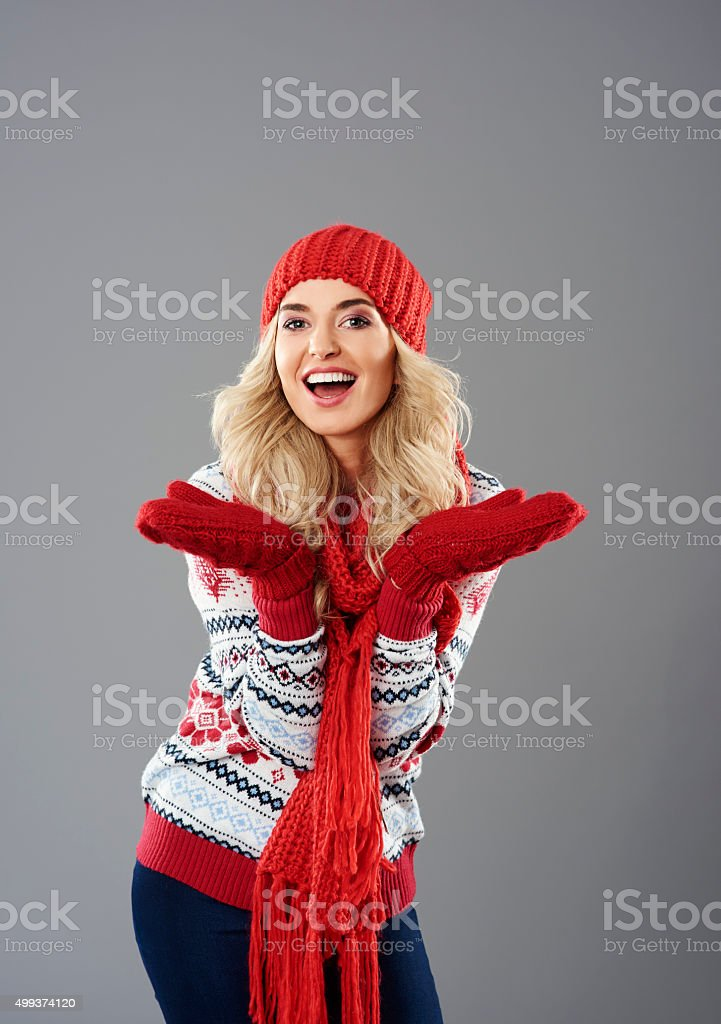 Positive emotions of woman in winter clothing