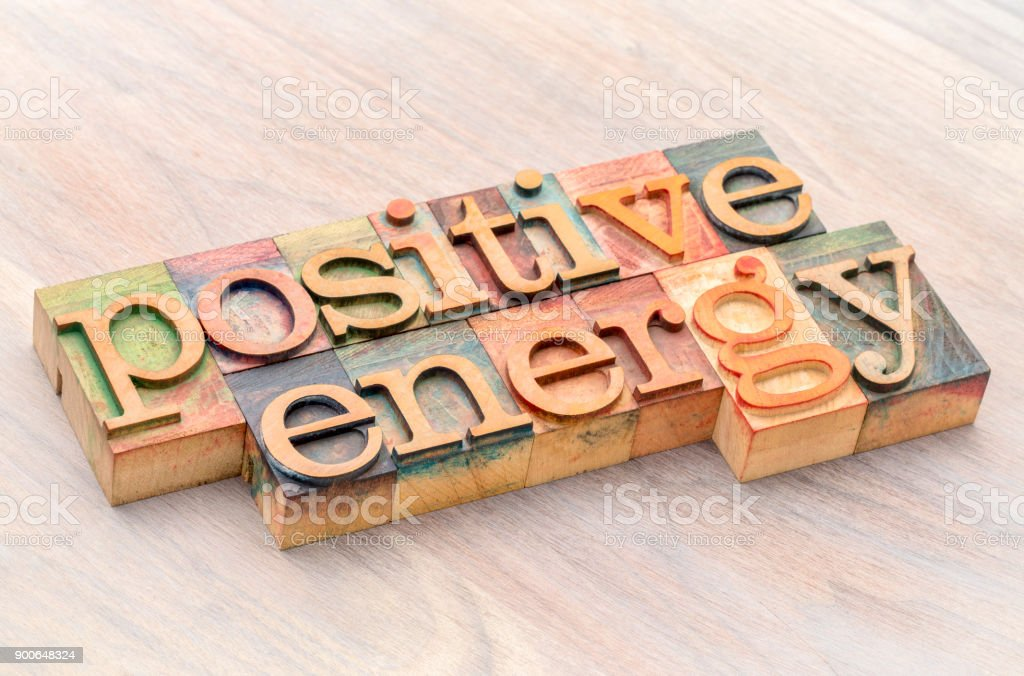 positive energy word abstract in wood type stock photo