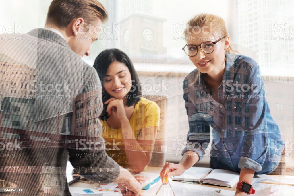 Positive female engineer working with her colleagues stock photo