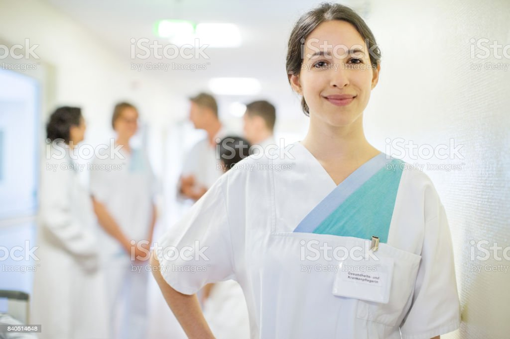 Positive female nurse in nursing home stock photo