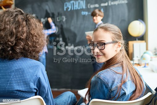 Pretty student turning around to look at camera