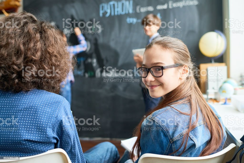Positive girl at lesson stock photo