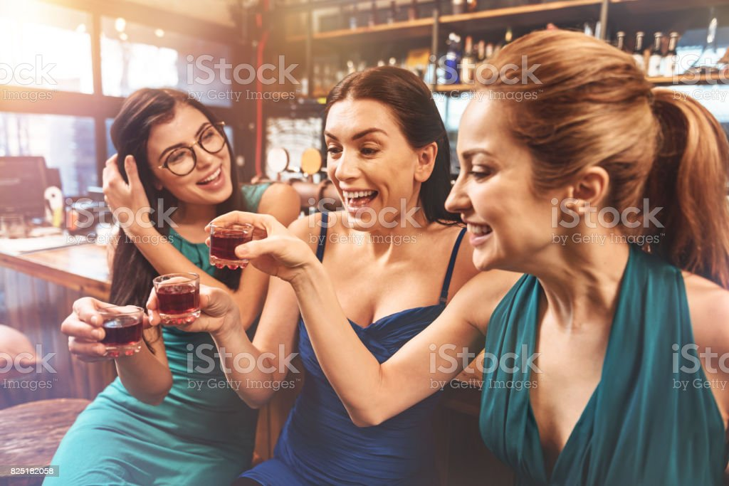 Positive girls celebrating hen party of their friend stock photo