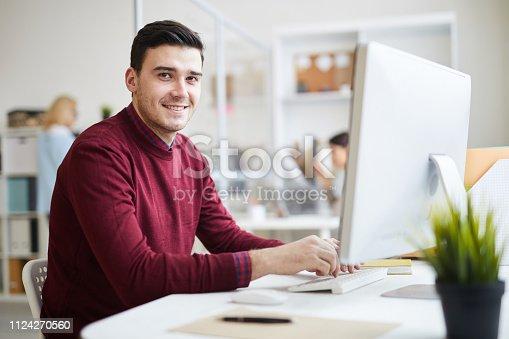Handsome graphic designer at work