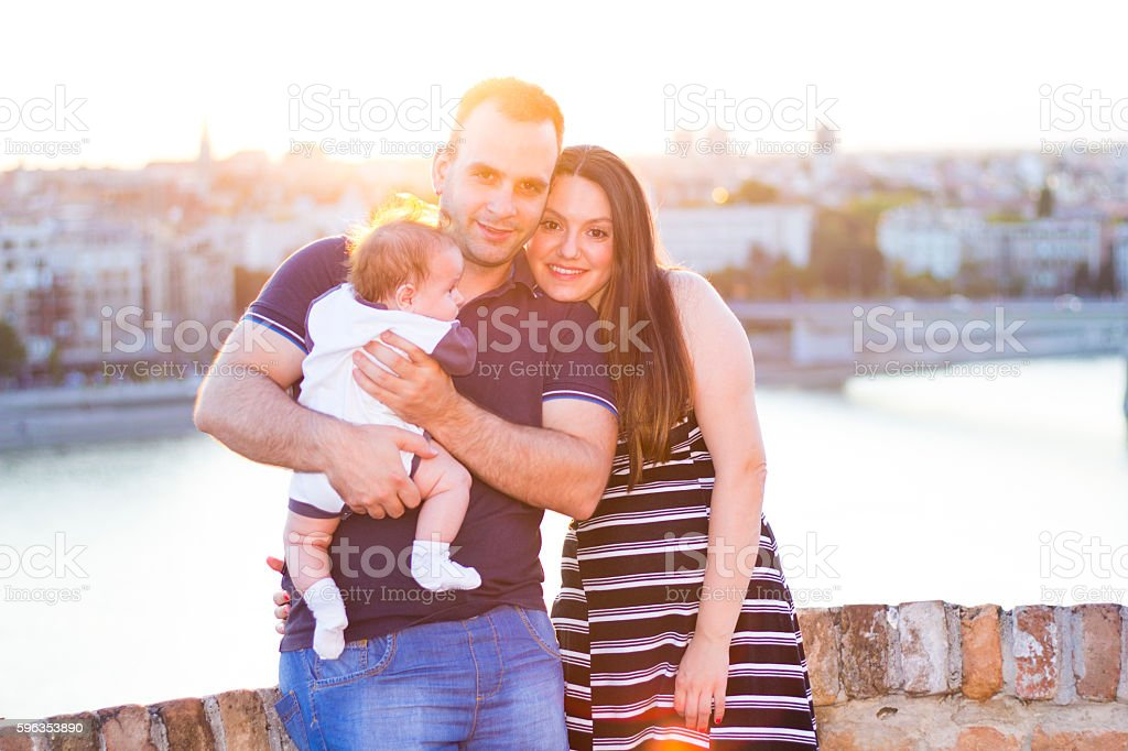 Positive happy family with little baby on the sunset royalty-free stock photo