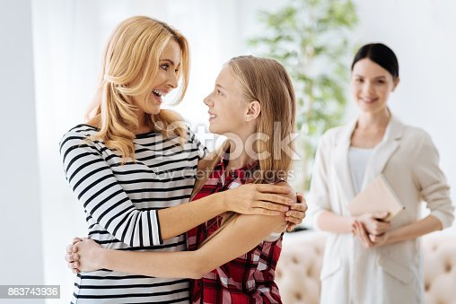 istock Positive happy mother and daughter looking at each other 863743936