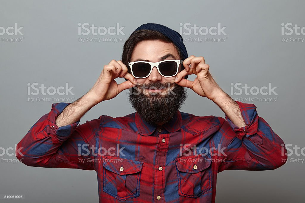 Positive hipster style bearded man stock photo