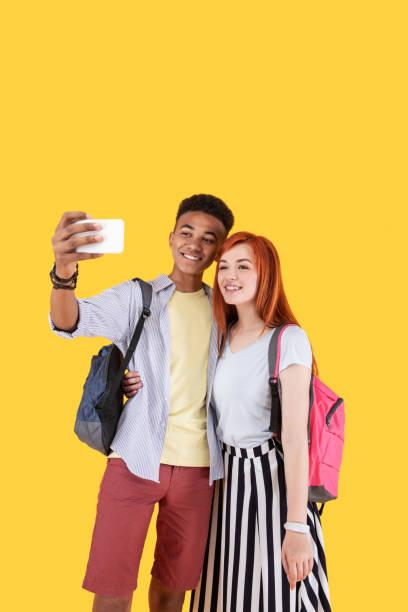 Positive joyful friends taking a selfie picture id973857682?b=1&k=6&m=973857682&s=612x612&w=0&h=  jtraci lbl3ggmjeq7hg147s8lald1f6w2y bif8q=