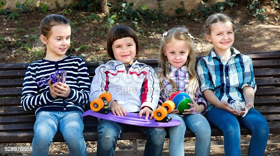 istock Positive kids posing together outdoor 525976588