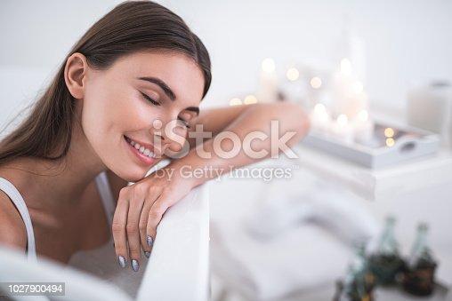 istock Positive lady having leisure in foam water 1027900494