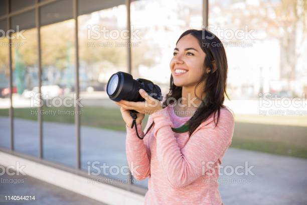 Positive lady taking photos with camera outdoors picture id1140544214?b=1&k=6&m=1140544214&s=612x612&h=zelhdvhsxgjspzhe93cijgklugbtaafc bvz kuwx4w=