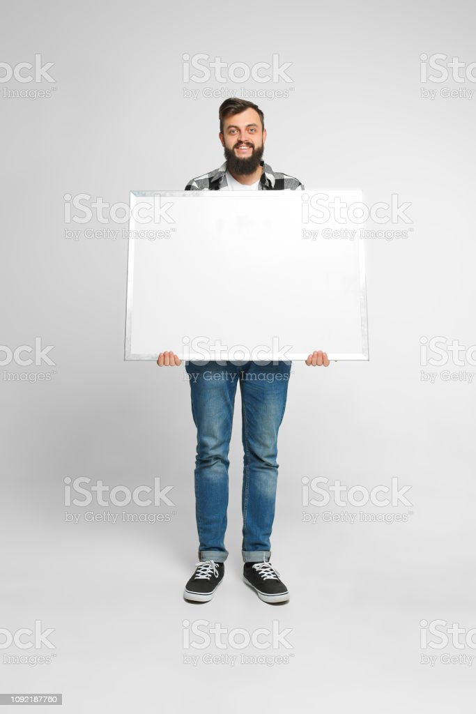 Positive man with mockup poster stock photo