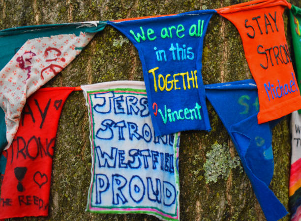 positive messages written on a sign on a tree by kids for corona virus covid-19 relief westfield, nj new jersey - first responders стоковые фото и изображения