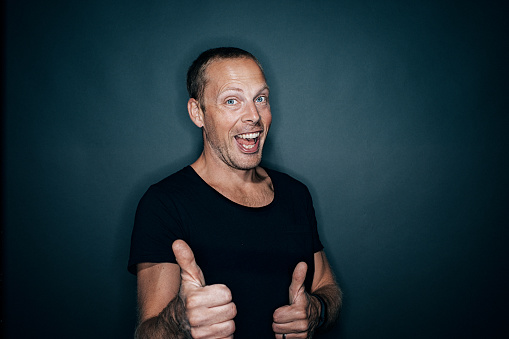 istock Positive mid adult man doing thumbs up 486129654