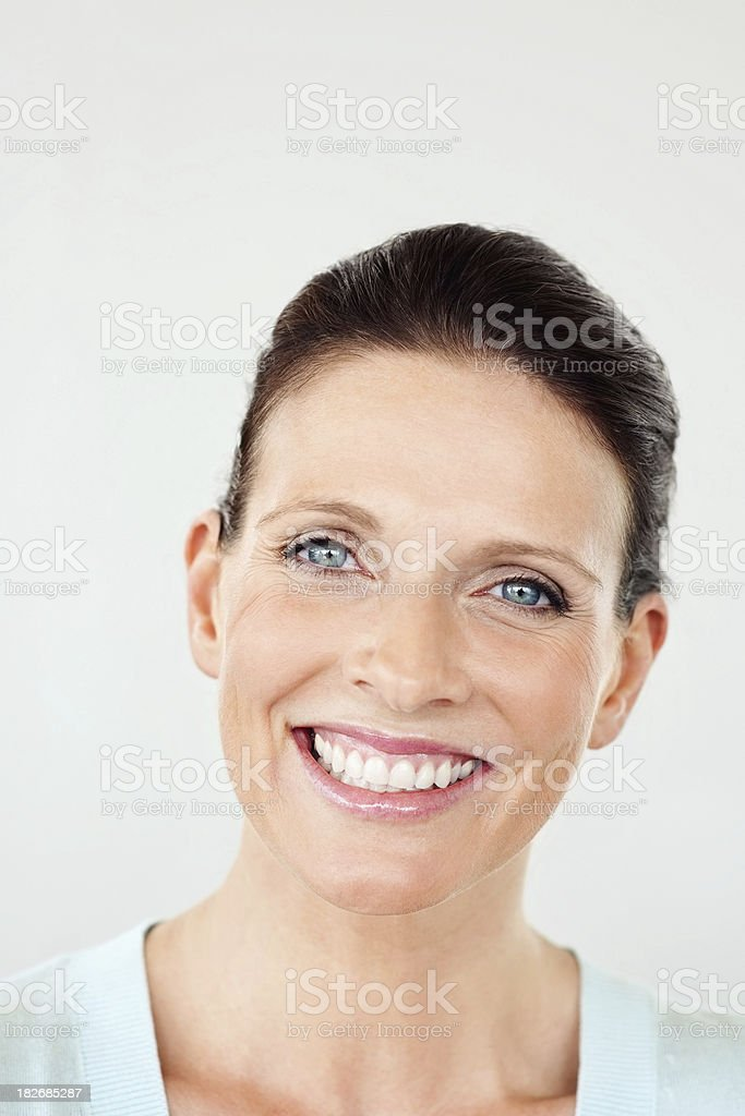 Positive middle aged woman giving you a warm smile stock photo