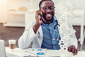 istock Positive minded young medical professional talking on phone and smiling 861247716