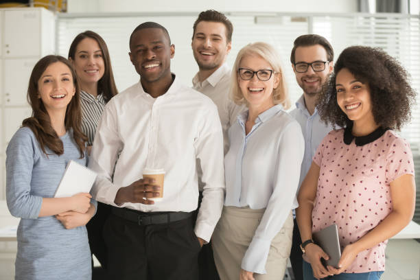 positive multi racial corporate team posing looking at camera - variation stock pictures, royalty-free photos & images