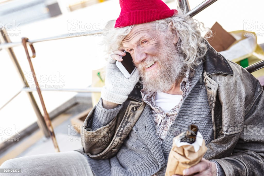 Positive nice man making a phone call royalty-free stock photo