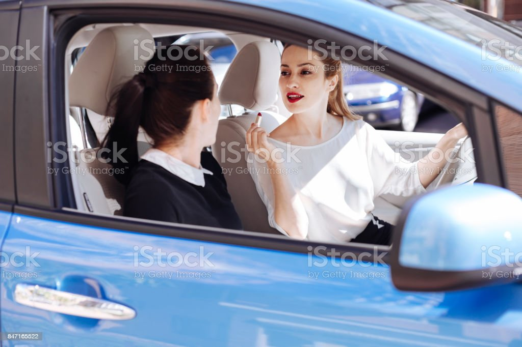 Positive nice woman looking at her colleague stock photo