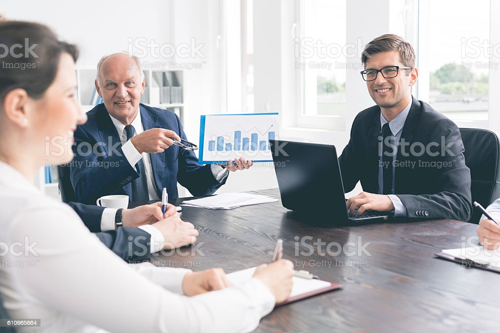 Positive office meeting at a massive table stock photo