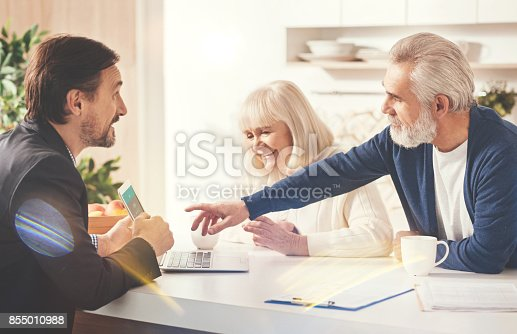 istock Positive old couple meeting with their insurance agent 855010988
