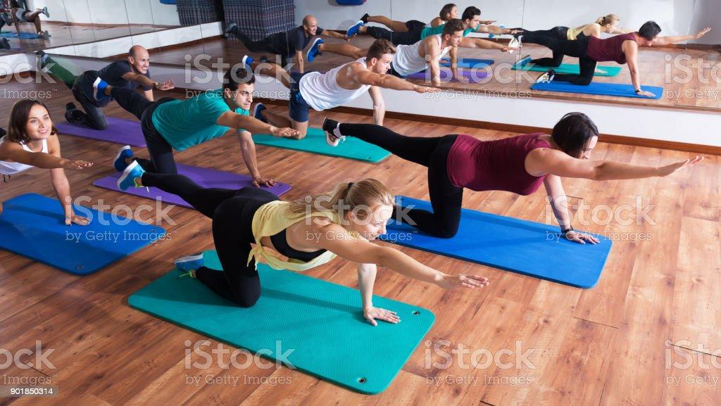 Positive people practicing yoga stock photo