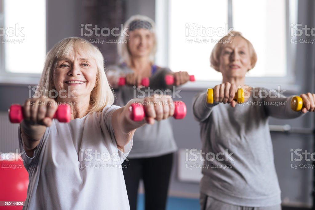 Positive persistent women trying to lose some weight royalty-free stock photo