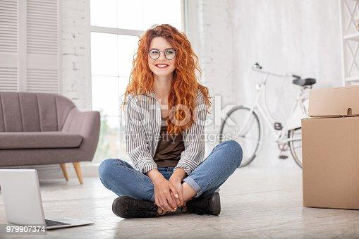 istock Positive pleased woman packing belongings 979907374