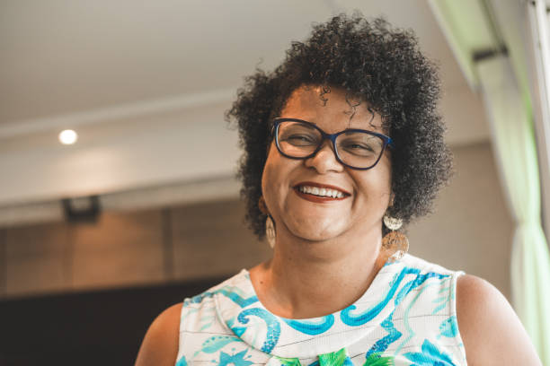 Positive portrait at home Females, Overweight, 45-49 Years, Adult, Adults Only brazilian ethnicity stock pictures, royalty-free photos & images