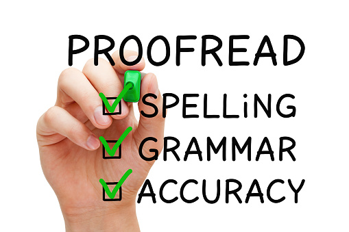 Hand filling Proofread checklist concept with checked boxes on spelling, grammar and accuracy.
