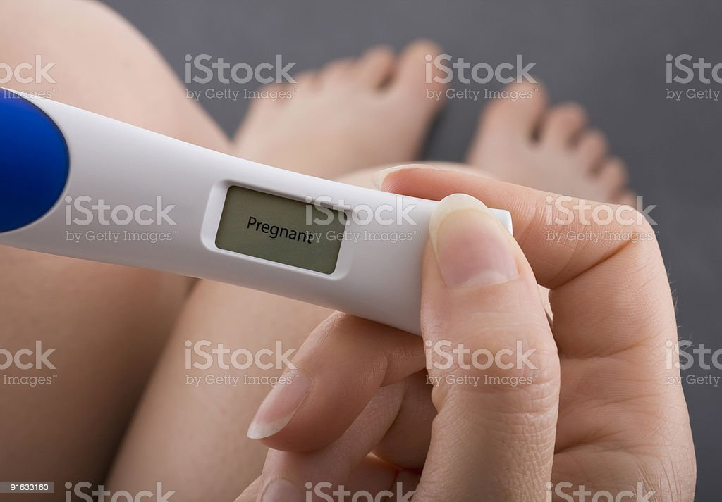 Positive result of pregnancy test stock photo
