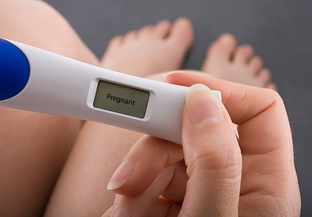 positive result of pregnancy test - family planning stock photos and pictures