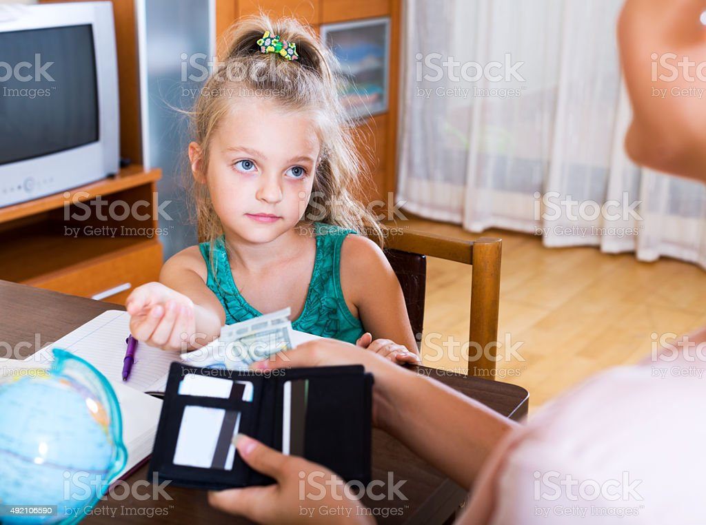 Positive schoolgirl asking money stock photo