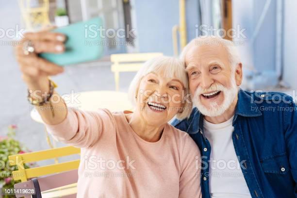 Positive senior couple taking selfie picture id1011419628?b=1&k=6&m=1011419628&s=612x612&h=80dexetjivvlhvyqxy5o5nssewvels5etzc1z9m5owa=