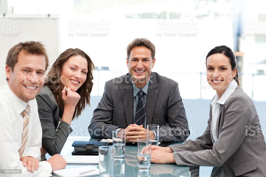Positive team smiling at the camera royalty-free stock photo