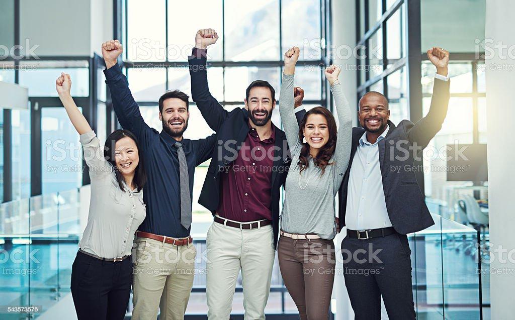 Positive teams produce positive outcomes stock photo